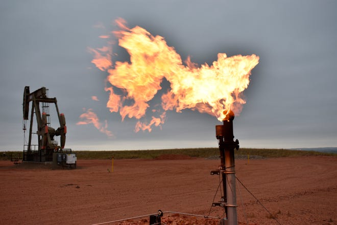 A flare burns natural gas at an oil well Aug. 26, 2021, in Watford City, N.D. Consumers of natural gas are facing the prospect of much higher heating bills this winter. That's after enjoying a prolonged period of low prices.