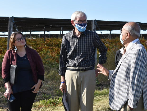 Gov. Tony Evers, center, and Wausau Mayor Katie Rosenberg, left, speak with Paul Hsu, who founded Hsu's Ginseng Enterprises after immigrating from Taiwan, on Sept. 30, 2021. A new trade agreement with Taiwan will open that market to fresh ginseng grown in Wisconsin.