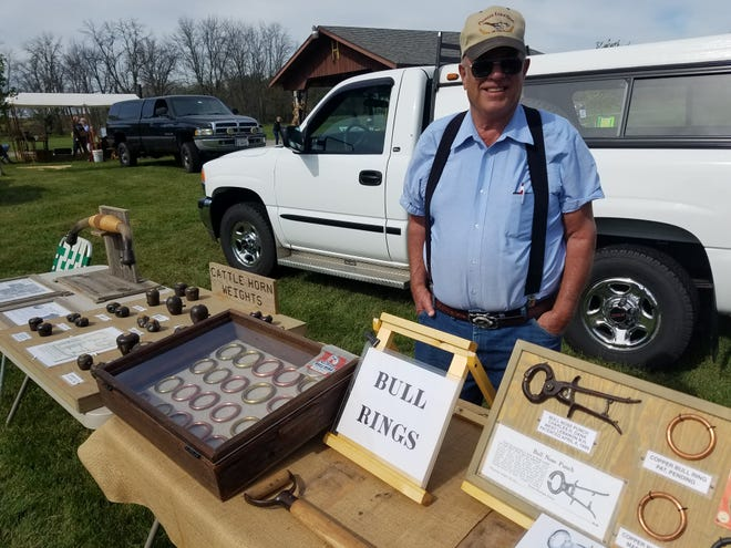 Carl Friesch, Sullivan, displayed his unique collection of horn weights at Harnischfeger Park at Ashippun last week and shared stories about how these pieces are used to shape the horns on cattle.