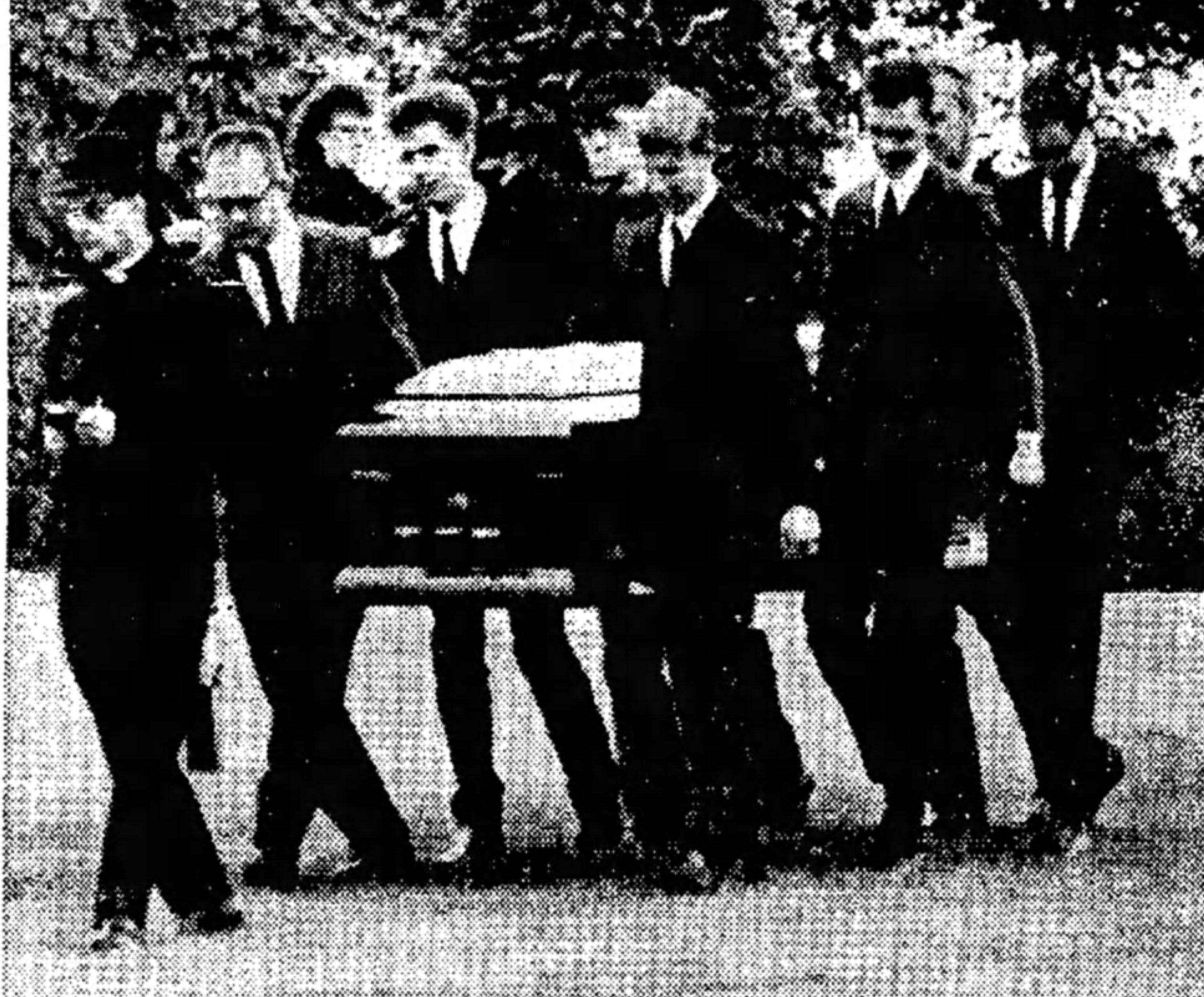 Mourners carry Peggy Reber's casket to its gravesite at Grand View Memorial Park during a funeral service on May 29, 1968.