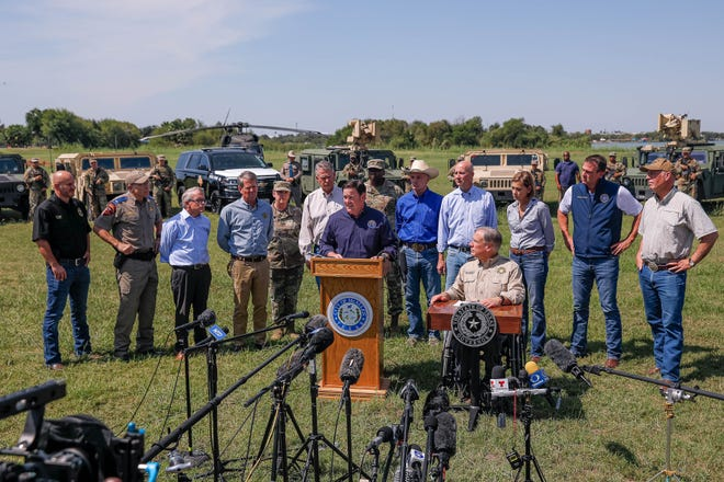 Arizona Gov. Doug Ducey joins other Republican governors, military leaders and law enforcement officers at a press conference on the Texas-Mexico border in Mission, Texas on Oct. 6, 2021, to speak on the Biden administration's border response.