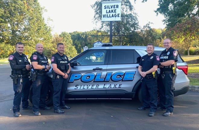 The Silver Lake Police Department is taking part in the Pink Patch Project fundraiser during the month of October. The department is selling pink patches and the proceeds from the sales will be donated to the Falls Cancer Club and possibly another group, too. Officers will be wearing the pink patches on their uniform throughout the month. Pictured from left are: Officers Cody Hostetler, Michael Hudson, and Ed Beverage, Lt. Dave Childers and Officer Craig Rowe.