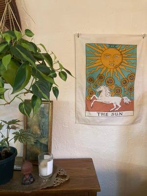 A nice tapestry can cover a thermostat or any other eyesore on your wall.