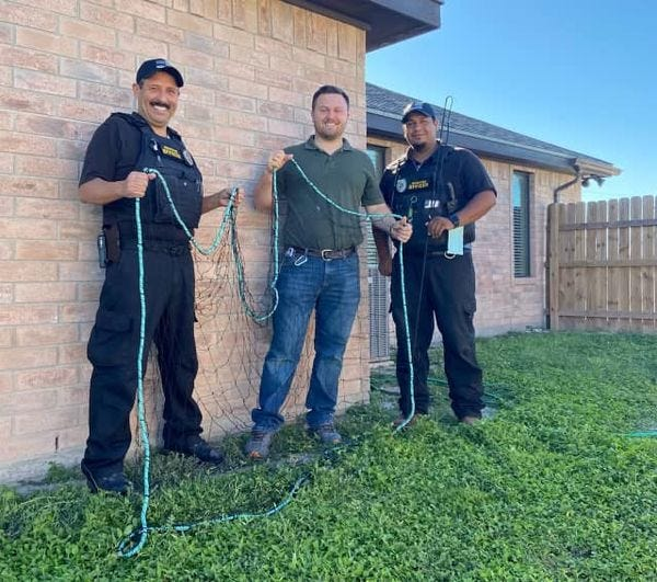 Alice Animal Control Officers received a net and catch pole donation from Dr. Sam Wilkinson, owner of Wilkinson Veterinary.