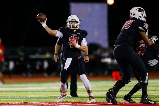 Melissa Cardinals quarterback Sam Fennegan (11) passes for a first down during the Melissa Cardinals vs Argyle Eagles high school football game at Cardinals Stadium in Melissa, Texas on October 1, 2021. (Photo by Matt Pearce/Buzz Photos)
