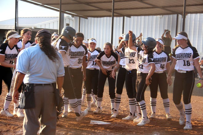 The Lady Horns celebrate at home earlier this season. Lone Grove looks to do more of the same when it hosts Ada at noon Thursday to open play in a Class 4A Regional.