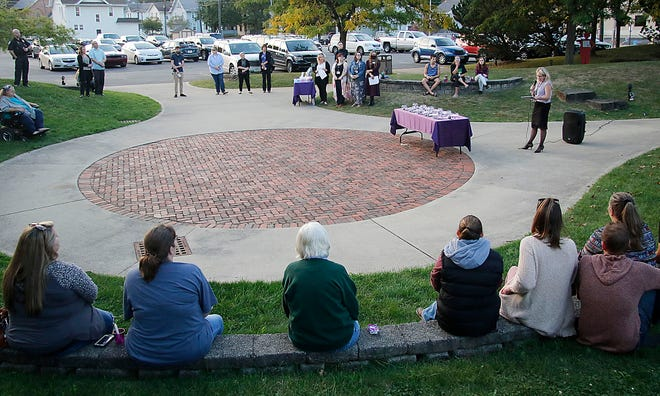 Safe Haven's Rebecca Jentes speaks at the Domestic Violence Candlelight vigil in Corner Park on Tuesday, Oct. 5, 2021. Work on Corner Park approved by the Ashland County Commissioners at their Thursday, Oct. 7, 2021 meeting will include sidewalk, curbing and lighting work.