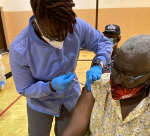 David Lewis, 68, of Augusta, receives his first shot of Pfizer COVID-19 vaccine from Nicole Miller, an EMT-Advanced with the Richmond County Health Department at a city vaccination event at May Park Community Center. Oct. 6,2021