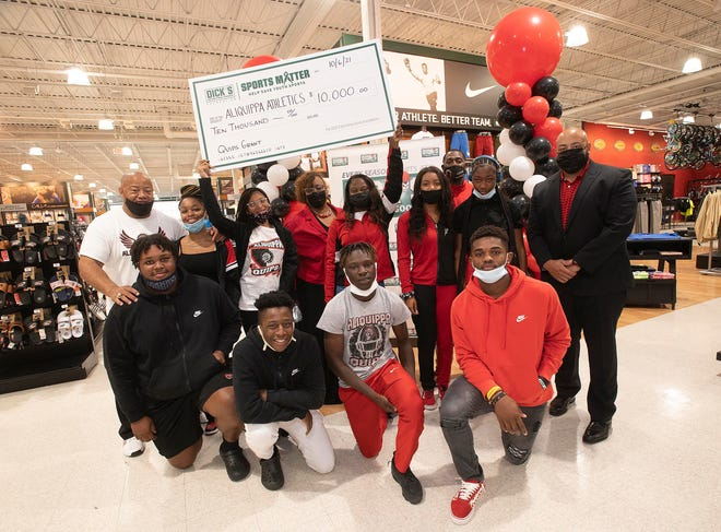 Aliquippa coaches, administrators and track athletes pose after Dick's Sporting Goods awarded the Aliquippa track program with a check for $10,000, Wednesday at the Beaver Valley Mall.