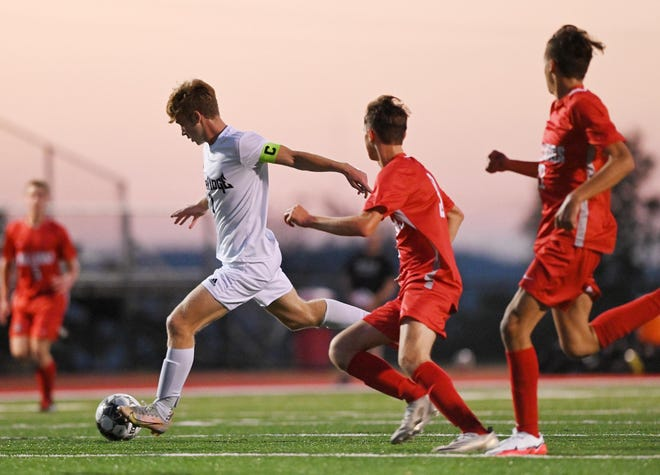 Ambridge's Will Gruca takes control of the ball ahead of Freedom defenders during Tuesday night's game at Freedom.