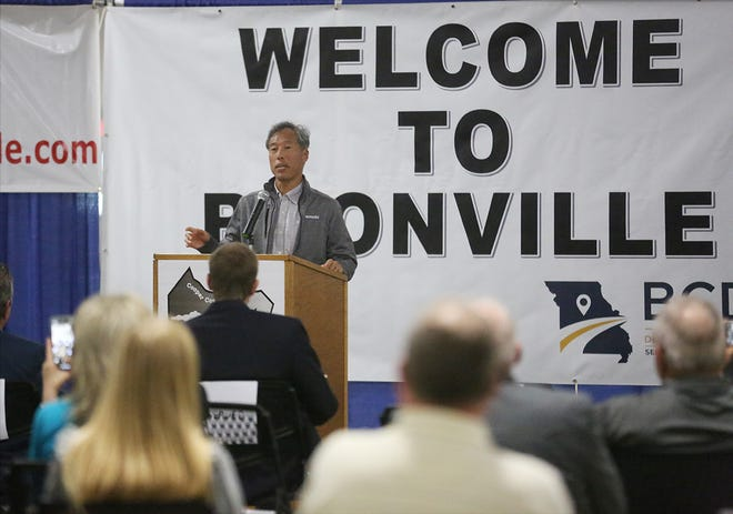 """Yutaka """"Joe"""" Tabata, president of Kawasaki Motors Manufacturing Corp., U.S.A., speaks to a crowd at the former Nordyne plant Wednesday to announce that Kawasaki is opening up a manufacturing plant in Boonville."""