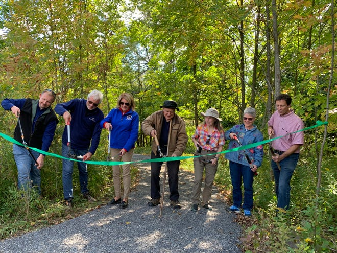 Canandaigua Town Manager Doug Finch, FLLT board president Dave Birchenough, State Senator Pam Helming, volunteer Marty Dodge, landowners Duannah Barnum and Suzie Underhill, and FLLT Executive Director Andy Zepp at the ribbon cutting ceremony for the new Canandaigua Vista Nature Preserve.