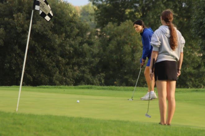 Scarlet Polson of the Brookfield High School Lady Bulldogs rolls a putt toward the cup on Green Hills Golf Course hole No. 4 during the Lady 'Dogs' Tuesday, Oct. 5, double-dual match against Chillicothe and Tina-Avalon in Chillicothe. Although this putt didn't go in, Polson did earn match co-medalist honor with a round of 47 as Brookfield defeated both foes.