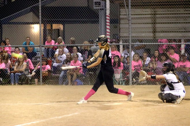 """Junior """"flex"""" player Ella Lowe of the Marceline High School softball Lady Tigers rips one of her four hits – inluding a pair of home runs – during the Sept. 27 win at Brookfield. Lowe had one of the team's 13 hits in last Monday's 12-2 5-innings home victory over Trenton."""