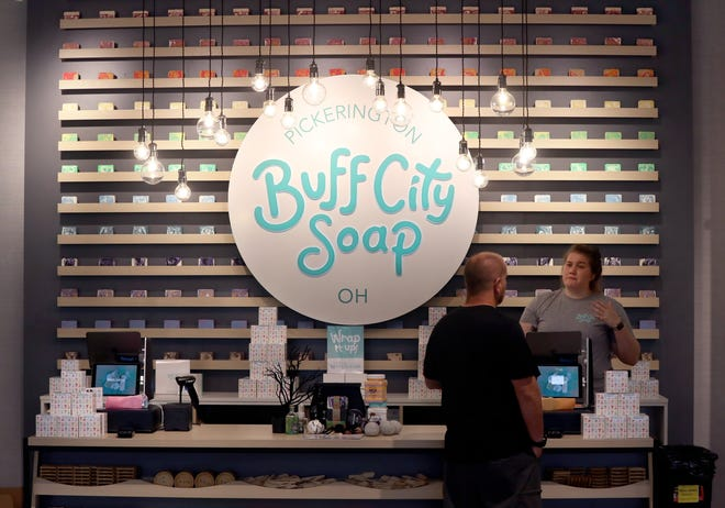 Manager Taylor Ducharme assists a customer Oct. 4 at Buff City Soap in the Pickerington Plaza at 10709 Blacklick Eastern Road.  Store hours are 10 a.m. to 7 p.m. Monday through Thursday; 10 a.m. to 8 p.m. Friday and Saturday; and noon to 6 p.m. Sunday.