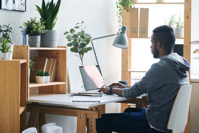 """Over the past year, Black workers in so-called """"knowledge"""" roles, like graphic design or data analysis, are more likely to say they've been treated more fairly, value their co-workers more and feel more supported by management, according to a survey by the Future Forum, a research consortium created by software maker Slack Technologies. (Dreamstime/TNS)"""