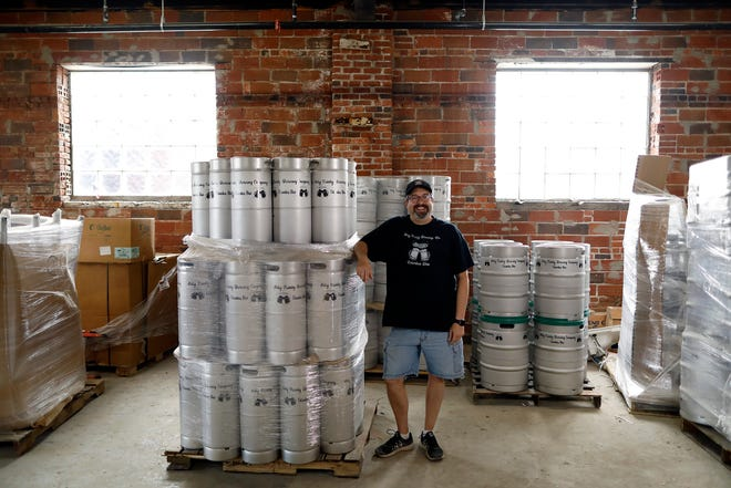 Tim McFeely inside the building at 155 N. 5th St. Downtown where he hopes to open Holy Trinity Brewing Co. in November with his wife, Joann. Renovations are ongoing.