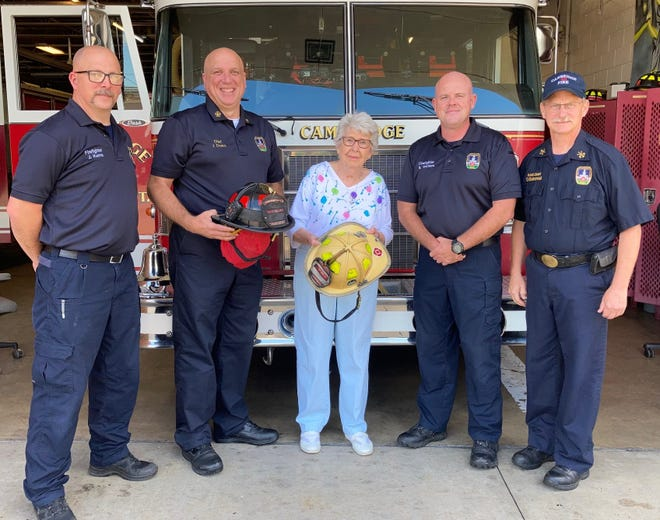 The Cambridge Fire Department received a $3,000 donation from local collector Laura Bates after she sold a 6-foot statue of William Boyd on Saturday. The donation will be used to purchase new helmets for fighters. Pictured, from left, are firefighter Jerry Kerns, Chief Jeff Deeks, Bates, firefighter Brian Vorhies and Assistant Chief Dave Duhamel at the Cambridge department.