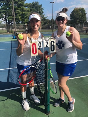 Cambridge High's number one doubles team of Ziciah Gibson, left, and Kara Loader, right, are shown following Tuesday's sectional tennis tournament at Dover City Park. Gibson and Loader advanced on to district play for the second time.