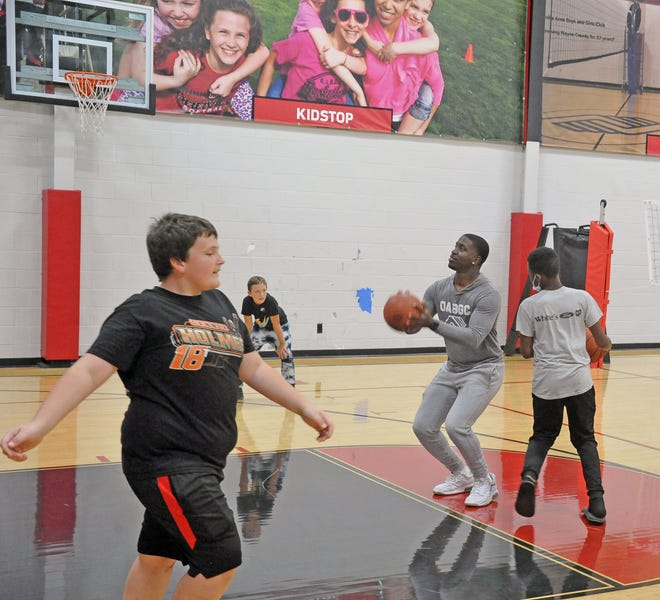 KeOntae Owens shoots a basketball as he practices with Walker Fairchild, Dominic Buriss and Jalen Bivins at the Orrville Boys and Girls Club.