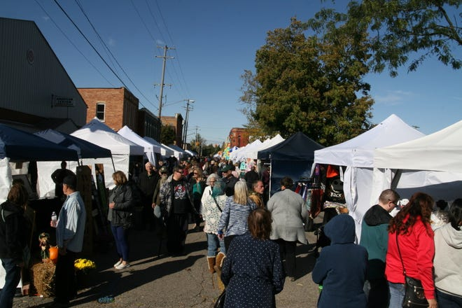 South Evans Street in Tecumseh is packed Oct. 13, 2019, during the Appleumpkin Festival. This year's Appleumpkin Festival and Kapnick Orchards Apple Festival are Saturday and Sunday, Oct. 9-10.