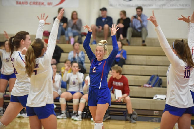 The Lenawee Christian volleyball team celebrates a point during Tuesday's match against Lansing Christian. [Telegram photo by Deloris Clark-Osborne]