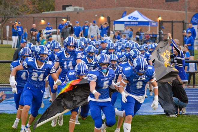 The Bulldogs run onto the field during a homecoming game against Nodaway Valley on Friday, Oct. 1 in Van Meter.