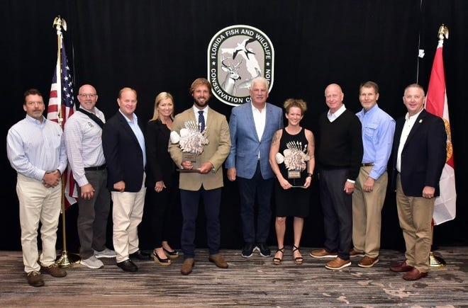 The 2021 Lionfish Challenge winners were honored at the FWC Commission meeting Oct. 6 in St. Augustine. Pictured from left are FWC Executive Director Eric Sutton; Commissioners Steven Hudson, Gary Nicklaus and Sonya Rood; Lionfish King/recreational winner Brooks Feeser; Chairman Rodney Barreto; Commercial Champion Rachel Bowman; and Commissioners Robert Spottswood, Gary Lester, and Michael Sole.
