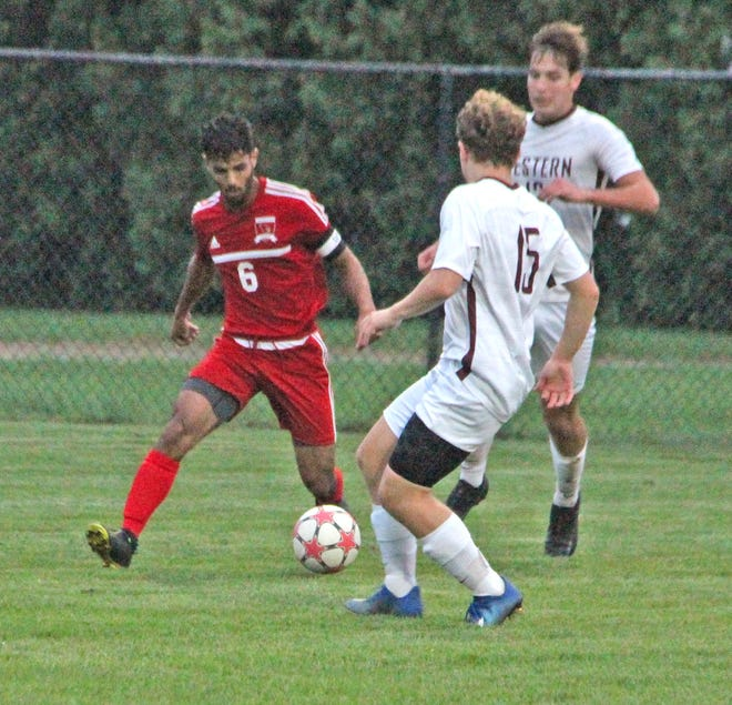 Coldwater's leading scorer Amine Mohammed works his way past several Parma defenders on his way to his second goal of the night Tuesday