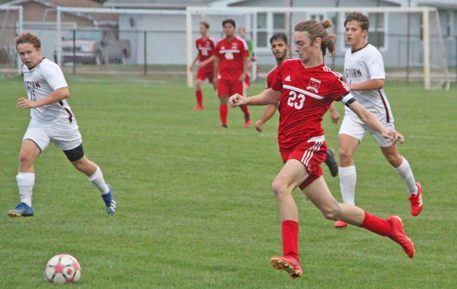 Coldwater's Joseph Closson (23) looks to move the ball up the field versus Parma Western Tuesday night