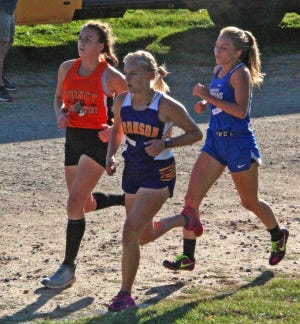 Bronson's Sidney Swick raced out to first place at the second Big 8 Jamboree on Tuesday while Quincy's Charlotte Crabbs finished in fourth place. The two, along with Springport's Saige Patterson are shown here at Homer