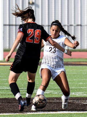 Garden City Comunity College's Miranda Cardona, right, steals the ball away from Cowley County's Angela Gatto during a September game at Broncbuster Stadium.