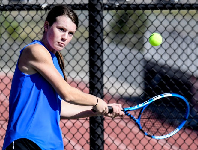 Garden City High School's Payton Tull hits a backhand shot in a doubles match in September during the GCHS girls tennis invite.  The Buffaloes captured the team title on Tuesday at Hutchinson.