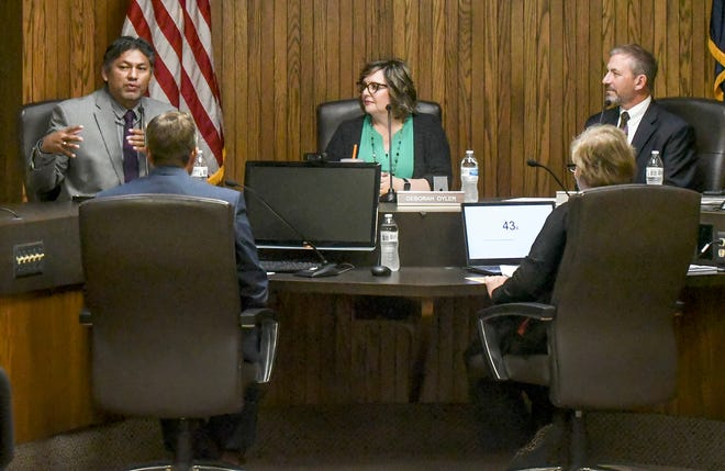 Manny Ortiz, left, answers a question as Deb Oyler and Troy Unruh look on Tuesday during a Garden City Area Chamber of Commerce candidates forum at the City Administrative Center.  The trio of candidates, all incumbents, are running for re-election to the Garden City Commission.