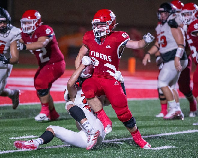 Glen Rose running back Sean Dodson breaks through the grasp of a would-be tackler Friday night.
