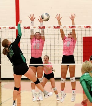 S&S' Brenna Howard (10) and Harlee Wooten set up a block against Valley View's Andee Renfro during the Lady Rams' win in District 10-3A play.