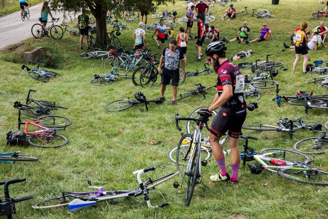 Riders rest at the last rest stop during the Hilly Hundred bicycle ride Oct. 6, 2018, near Bloomington.