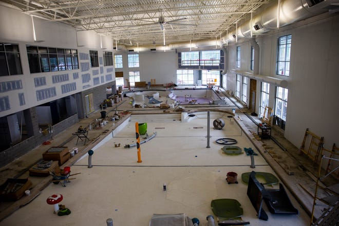 New construction for the expansion of the Holland Aquatic Center sits Tuesday, Oct. t, 2021. The $26.3 million expansion looks to attract a wider segment of the community through family-focused pools and exercise areas.
