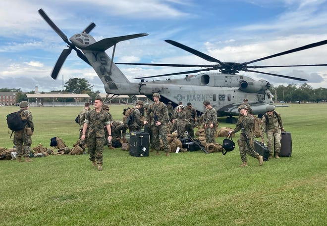 Marines with the 24th Marine Expeditionary Unit unload a CH-53E helicopter at W.P.T. Hill Field at Marine Corps Base Camp Lejeune, Oct. 6, 2021.