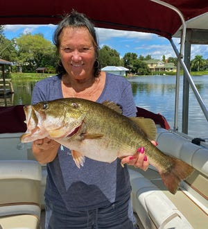 Marge Lawson of Plant City caught this 9-pound bass while trolling a deep diving lure at Crooked Lake last week.