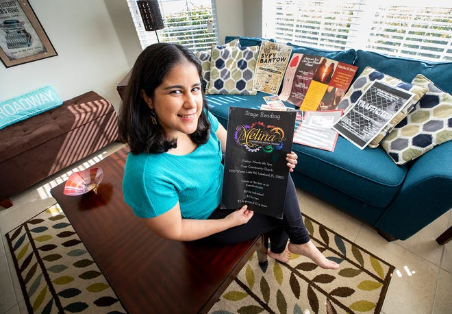 """Playwright Gretchen Suárez-Peña holds the poster for her musical """"Melina."""" It was selected for the 2020 Atlanta Musical Theatre Festival."""