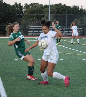 Frankfort's Marie Perdew battles for the ball with her Hampshire opponent. Hampshire topped Frankfort 6-1 on Tuesday.