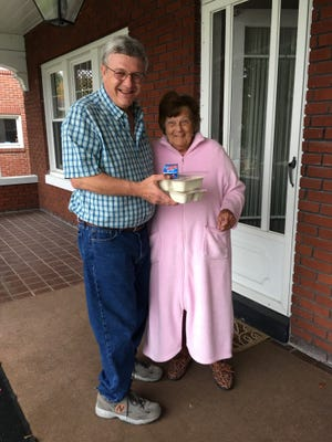 Jim Hoover delivers hot meals to long-time Meals On Wheels client Connie Boyce.