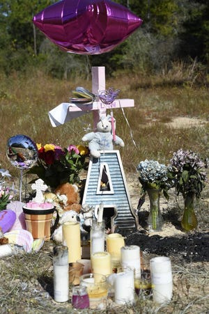 A small memorial was erected on Palmetto Drive in Crestview following the death of 3-year-old Adelynn Merrell in 2017. The girl's mother, Destinee Merrell, was sentenced Tuesday to 10 years in prison for her role in trying to cover up the child's death from a head injury.