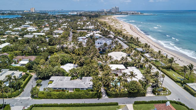 In the foreground, two side-by-side houses, including the oceanview house at 1285 N. Ocean Blvd., are being marketed together at a just-raised price of $25 million.