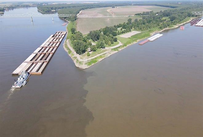 A barge is pictured at the confluence of the Mississippi and Ohio rivers, the potential site of the Alexander-Cairo Port District in southern Illinois.