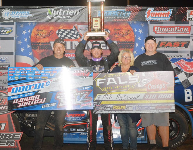 Mike McKinney celebrates as the $10,000 Casey's Modified Nationals race winner with members of his team. McKinney ended the year with six wins at Fairbury bringing his career total to 39 victories, the most wins by an active driver in the modified class. McKinney the 2016 track champion, also took the title this year.