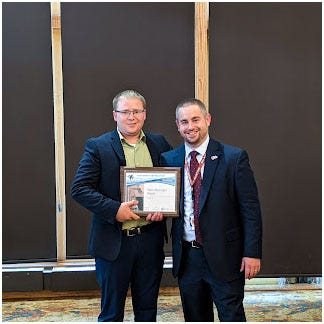 Director of Illinois Department of Transportation's Division of Aeronautics Clayton Strambaugh (right) presents the 2020 Illinois General Aviation Airport of the Year award to Pekin Municipal Airport manager Todd Dugan.