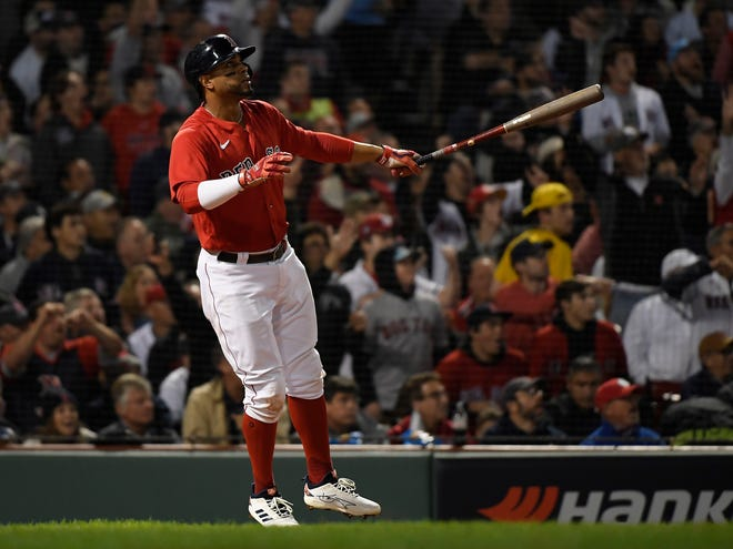 Red Sox shortstop Xander Bogaerts watches his two-run home run against the New York Yankees during the first inning Tuesday night.