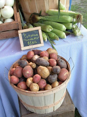 Buy potatoes from a local farmstand now to save for a winter meal later.